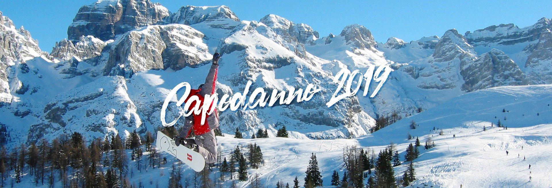 sfondo capodanno in montagna 2019 salto con lo snowboard